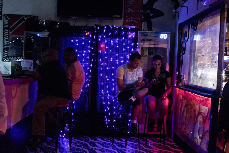 La Havana local bar in Port-of-Spain streets. As economy crumbles in Venezuela , desperate people travel 10 hours to buy food, supplies across the water in Trinidad, and some Venezuelans arenew immigrants informal workers in Trinidad.
