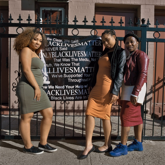 February 19, 2017 - Brooklyn, New York City, NY, USA - Ralph Avenue between Prospect Place and Park Place. (L to R) Naomi, Nancy and Uniqua standing in front of their Congregation, Peterson Temple COGIC.  In Ralph Avenue alone, there are around 14 religious sites out of 210 total religious sites in all of Crown Heights. Religious congregations, an important actor in the social fabric of Crown Heights, are also under risk of being closed to due to new developments.