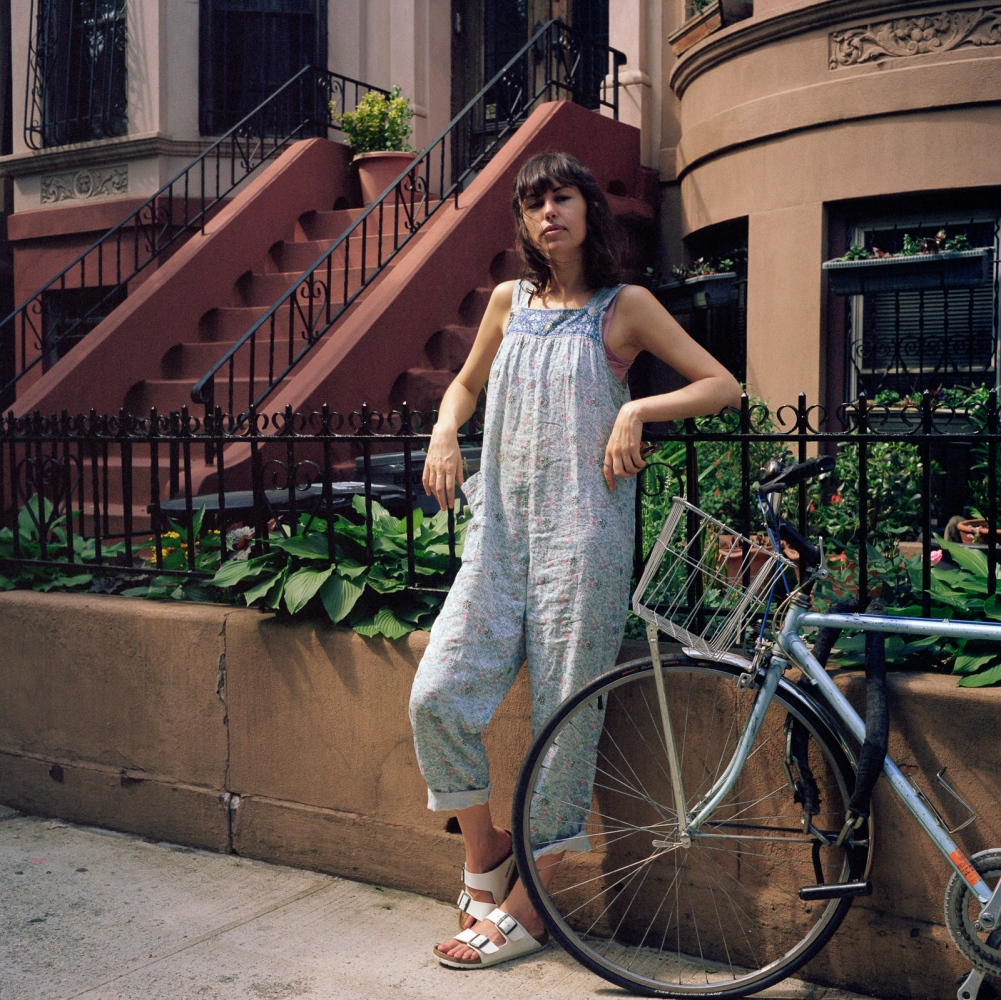 May 17, 2017 - Brooklyn, New York City, NY, USA - Farah Vulton, 36 years old, stands in front of her house on Dean Street. She is originally from California and has lived in Brooklyn for 7 years. One thing she loves about the neighborhood is its diversity. Between the 2000 and 2010 NYC census, white non-Hispanic population in Crown Heights has increased by 145%. Respectively, crime rates between 2001 and 2016 have dropped  by 40% (source NYPD).
