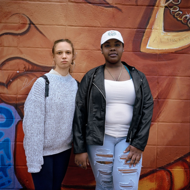 April 15, 2017 - Brooklyn, New York City, NY, USA - Brooklyn Avenue between Park Place and Prospect Place. Sandra Friedman (L) and Roichae McPherson-Joseph (R) meet four years ago and are now best friends. They said their friendship represents unity between the African American and Jewish communities in Crown Heights. In 1991 riots erupted between both communities when a car driven by a Hasidic Jew hit a young African American.