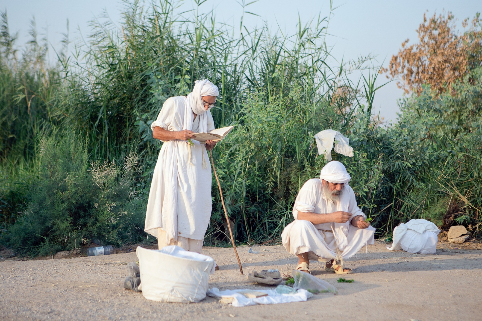 "One of the Mandean baptisms occurs at the time of marriage. A Mandean priest reads Ginza Rabba (""The Great Treasury"") Scriptures as part of ritual purification. They dress in white ""rastas"" which symbolize purity and during the ceremony.  Ahvaz, Iran.2016"