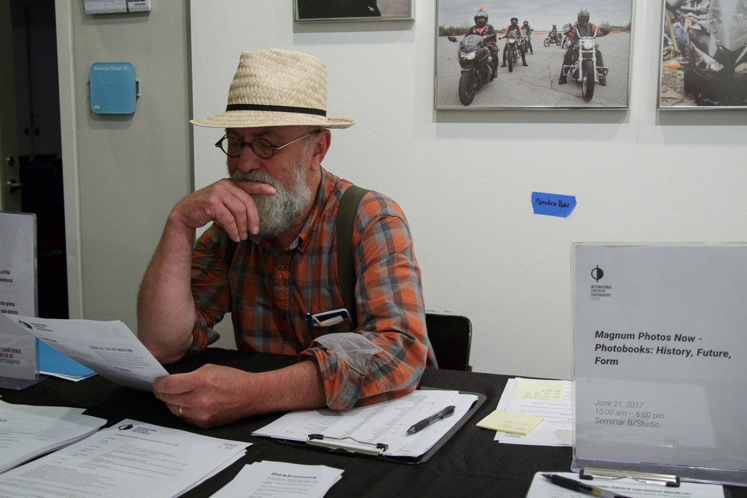 "June 21, 2017 - International Center of Photography School. New York City, NY, USA - Larry Towell sitting at the welcoming desk at the ""Magnum Photos Now- Photobooks: History, Future, Form"" event."