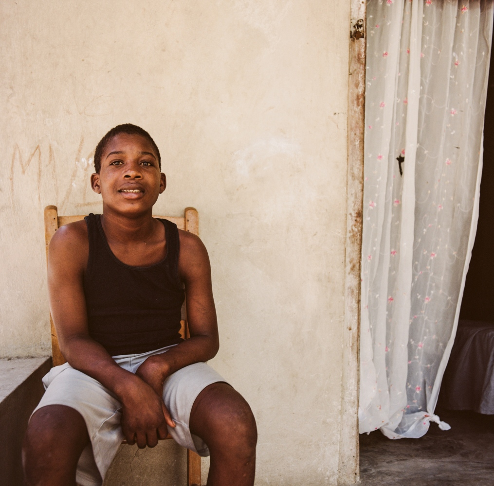 Commune of Jacmel, section Cayes - Haiti. Ronald,15, fell from a coconut tree and broke his wrists. He has been treated at Madam Paul's place for a month.