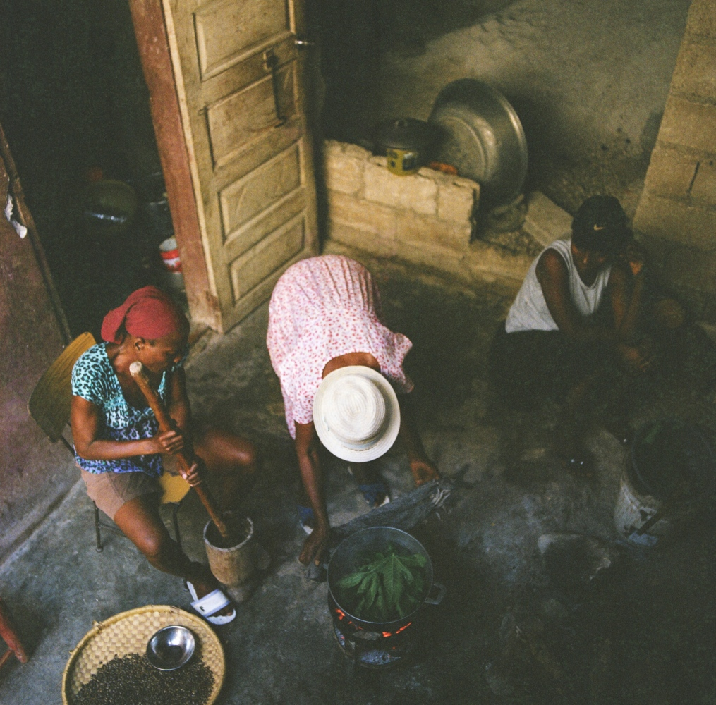 Commune of Port-au-Prince, section Martissant - Haiti. Preparation of castor oil with seeds and leaves collected on Elise Valdor's garden-roof.