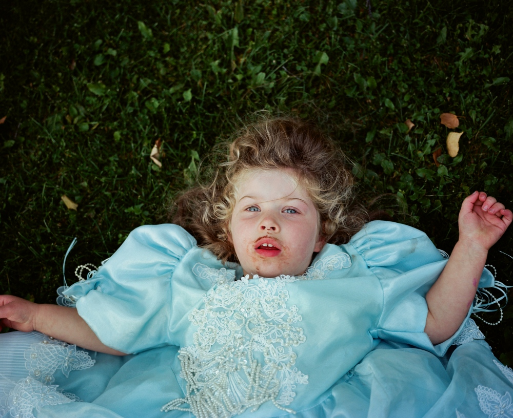 Rose Consenstein, 3 at the time of this photo, has a tantrum in her backyard after having a cupcake and putting on a princess dress.