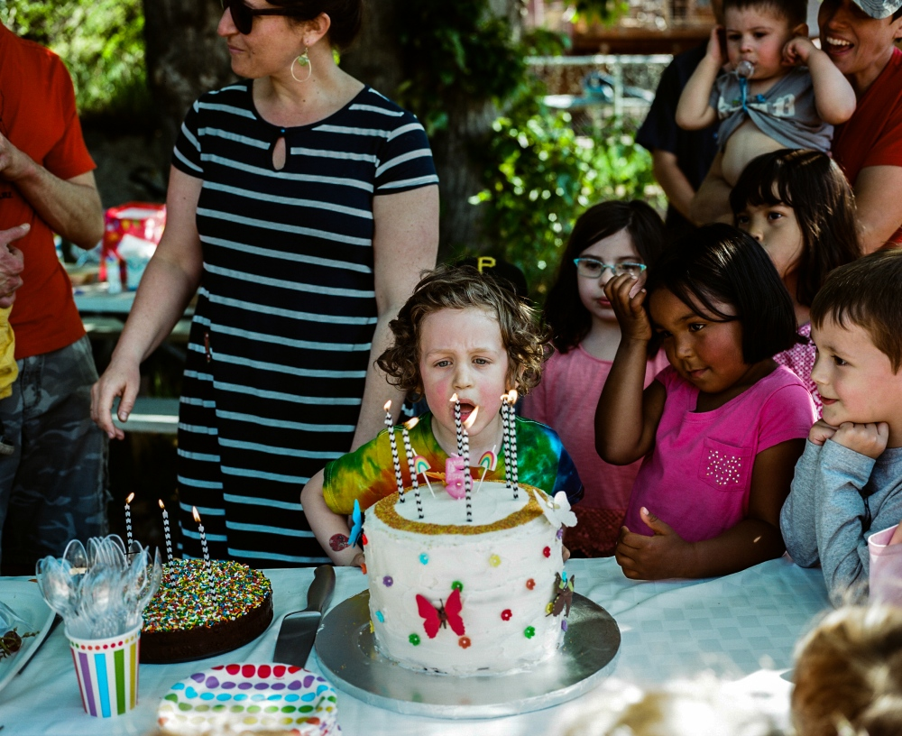 Yoel Schulgasser blows out the candles on his birthday cake at his fifth birthday party in midtown Anchorage. His mother (left) Tamar Ben-Yosef, made his cake.