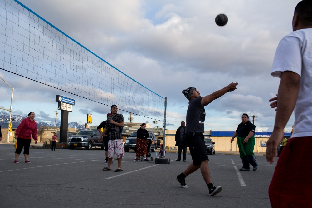 "The nightly volley ball game at the Congregational Christian Church of American Samoa in Alaska on Mountain View Drive. ""It's good for the community to keep the kids busy out here,"" says Jerome, one of the attendees."