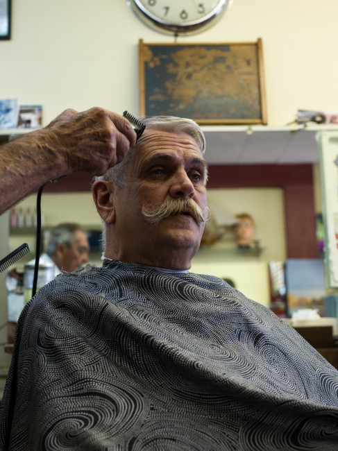 "Ben Clayton, 65, retired fire captain, has his hair cut at Bunn's Barber Shop on 4th Avenue in downtown Anchorage. Clayton says that Alaska has always been within reach to nucelar weapons, but that Alaska has millitary bases whose job it is to fend of these threats. The difference with current affairs, he says, is the diplomatic style of our current leadership in Washington. ""It's a true black swan event,"" he says."
