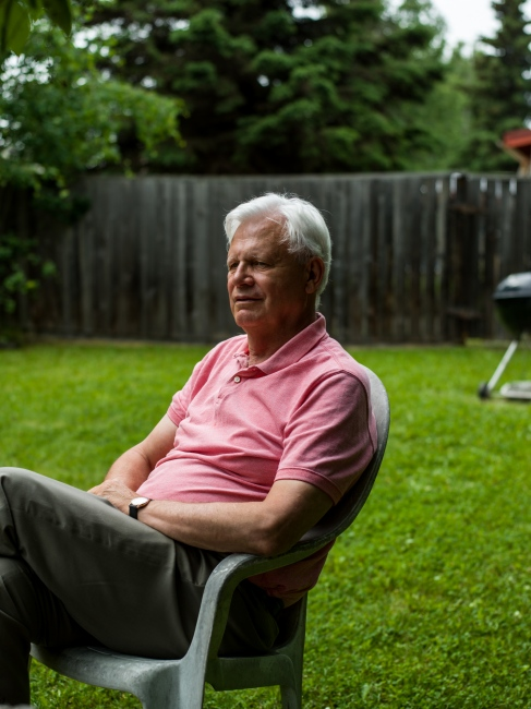 Journalist and historian MIchael Carey in his backyard in Anchorage, Alaska. Carey, born in 1944, spent years in the 1970's and 1980's studying and writing about civil defense, and says that he is currently working on an article about North Korea's recent threat to Alaska.
