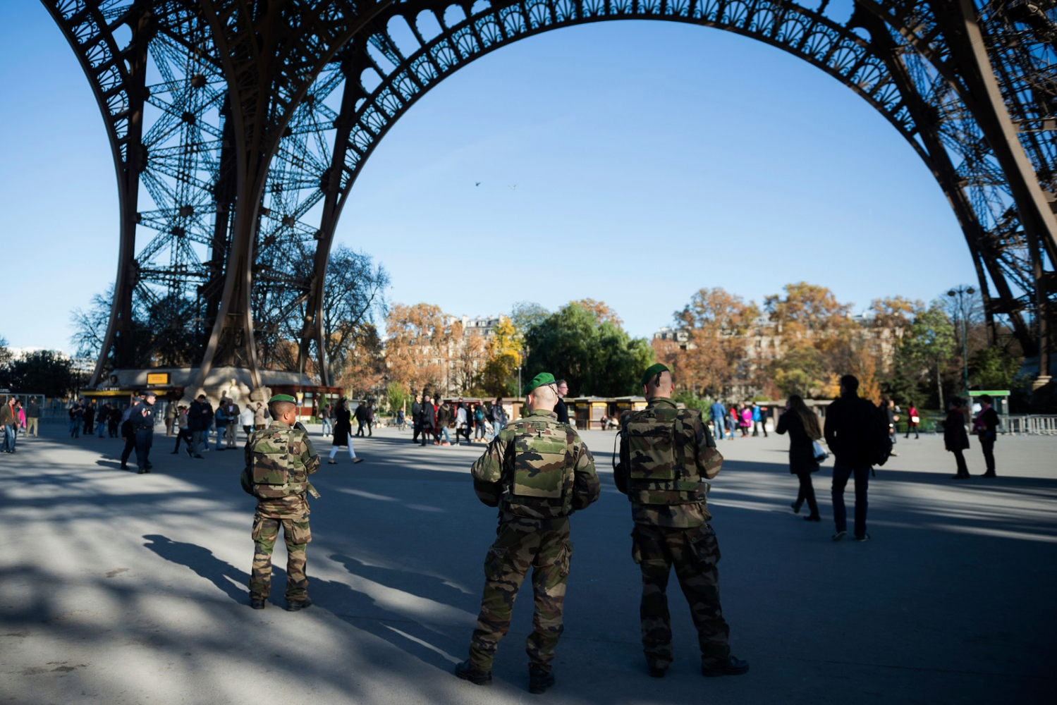 Soldiers patrols the streets under the Eiffel tower two days after several coordinated terrorist attacks that left over a hundred people dead.