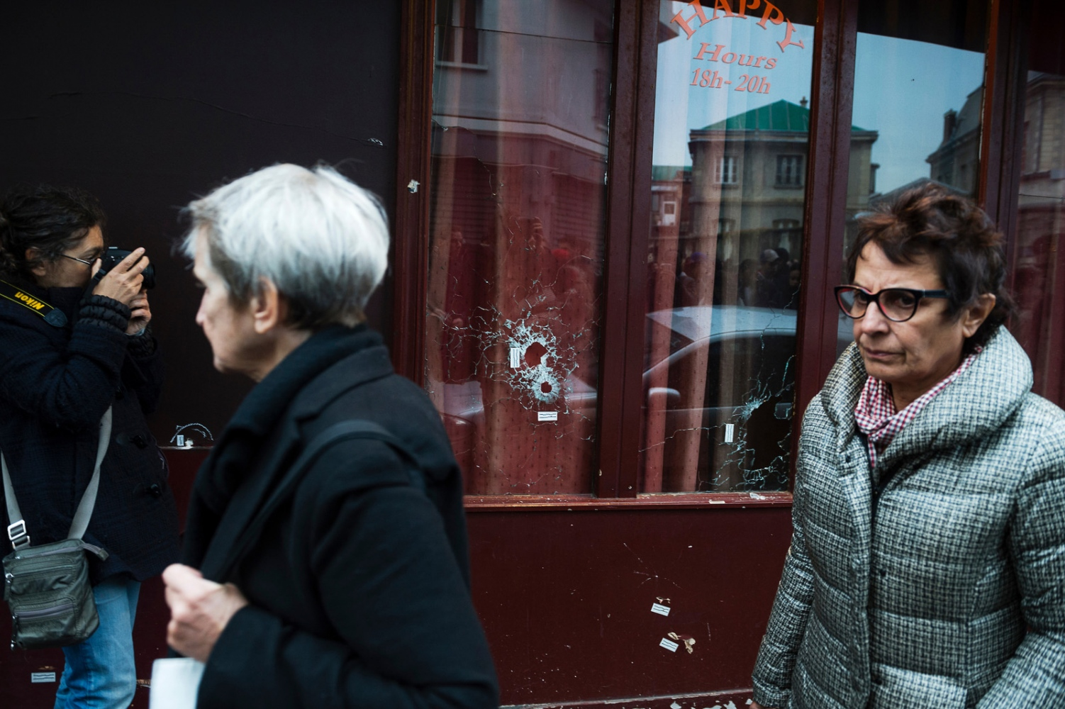 Bullet holes in the windows of the restaurant Le Carillon, where five people where shot to death in a terrorist attack. Several coordinated terrorist attacks in Paris, France, left over a hundred people dead.