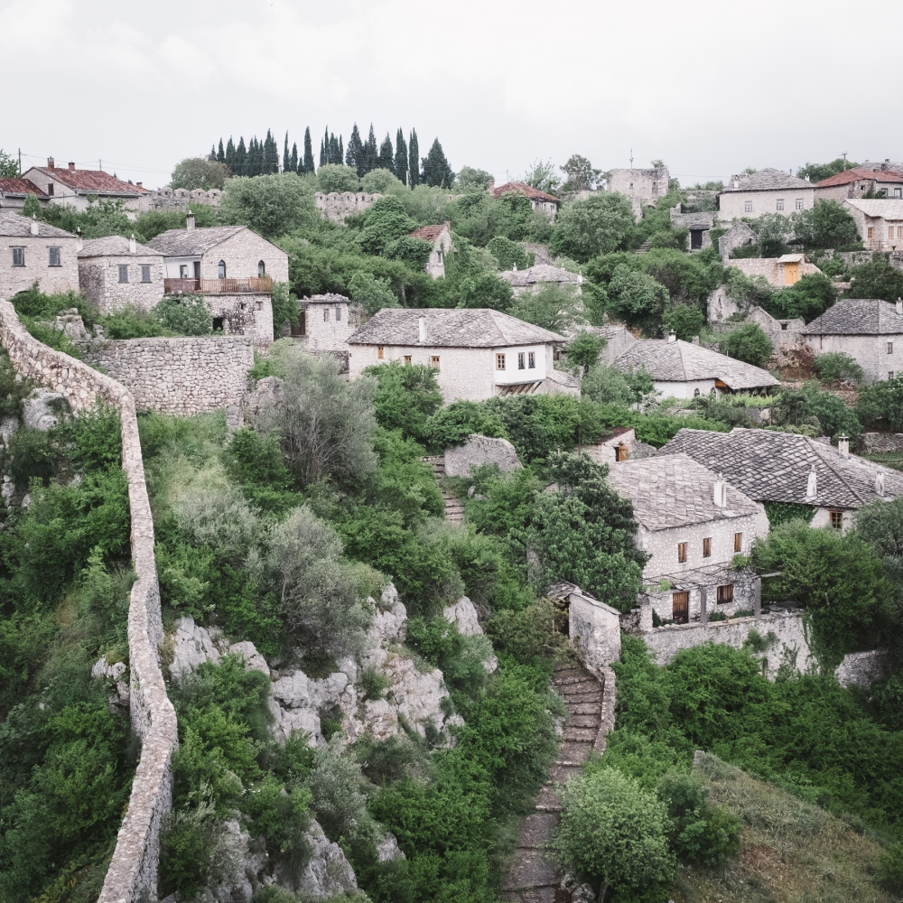 During the military occupation of Počitelj, most of the houses and cultivated fields were burned. The whole area was intentionally populated with snakes, so that the original population's return was quite impossible.