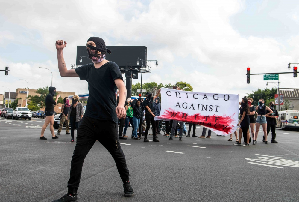 Photography image - 8.15.2017 following the preliminary hearing of a known White Supremacist. Antifa holds a demonstration outside Circuit Court Of Cook County.