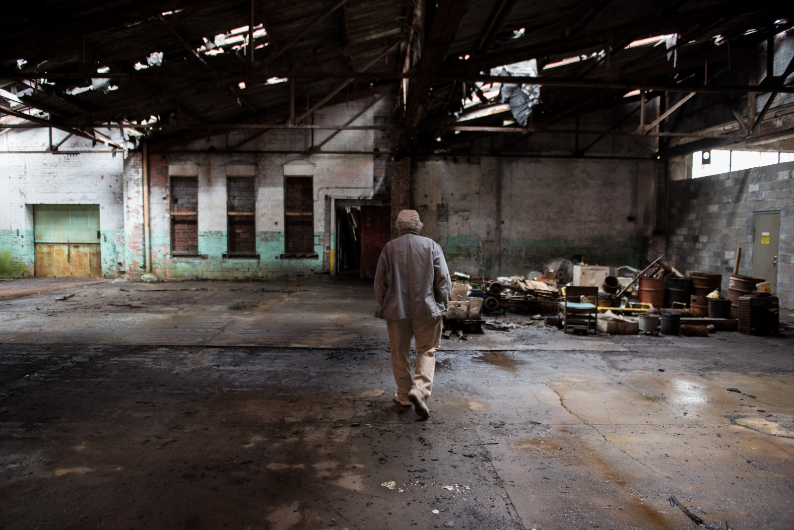 The current owner of the former Hazel-Atlas Glass Company building walks its cavernous interior.