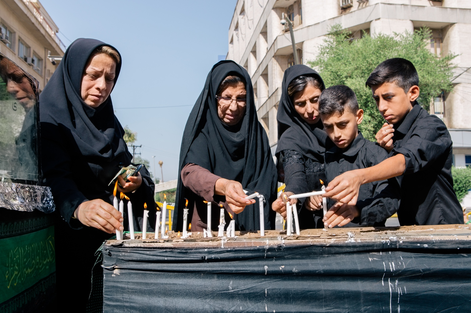 Muslims light candles in front of the Mandaean house On the day of Ashura (the tenth day of Muharram in the calendar. Commemorates the death of Hussain ibn Ali). To respect Muslims, Mandaean refuse to go out with white clothing. Ahvaz, Iran.2016.