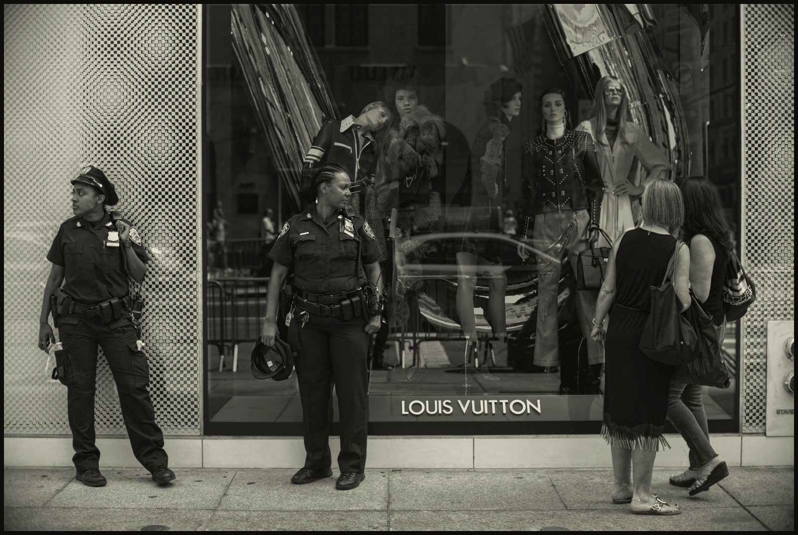 NYPD officers and shoppers in front of Louis Vuitton, Madison Ave. NYC, August 2017.