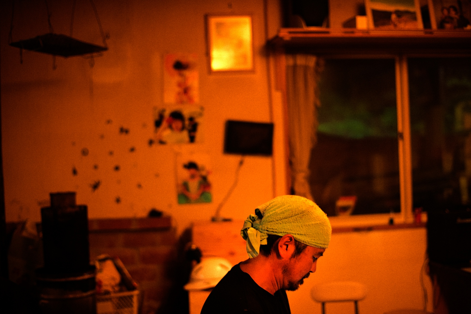 Norio Kimura(52) at his current home in Hakuba, a town about 400km from his former home in Okuma. Pictures of his deceased daughter Yuna Kimura, then age 6, can be seen in the back.
