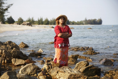 Jintana Kaewkhaw, a Thai environmental activist, stands on the coastline that was the proposed site for a coal-powered power plant. She successfully lead a protest group against a company that wanted to build a coal-powered electricity plant next to her village. In a landmark case the villagers won but it came at huge personal cost to herself.Ban Krut - Thailand