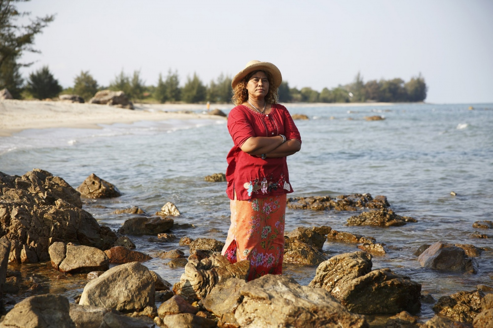 Jintana Kaewkhaw, a Thai environmental activist, stands on the coastline that was the proposed site for a coal-powered power plant. She successfully lead a protest group against a company that wanted to build a coal-powered electricity plant next to her village. In a landmark case the villagers won but it came at huge personal cost to herself. Ban Krut - Thailand