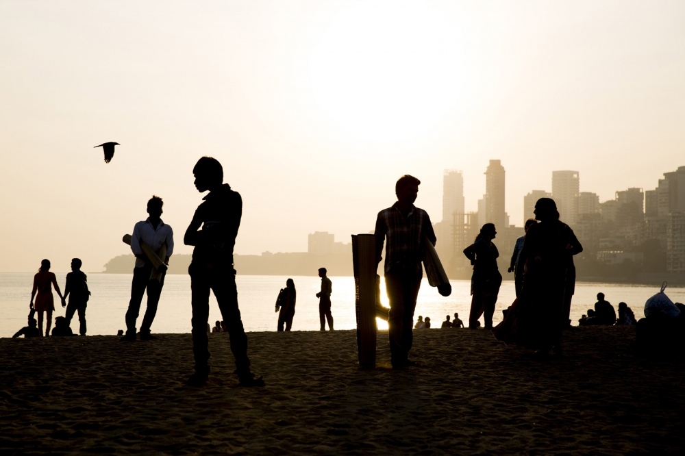 People enjoy Mumbai's most popular public beach in the late afternoon. Called Chowpatty beach many advise against swimming in the water here which is said to be heavily polluted. But this doesn't stop people enjoying the sand. India.