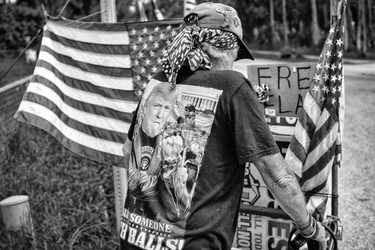 American Flag Sales Vienam Veteran on road side selling American Flags, New Symara, Florida