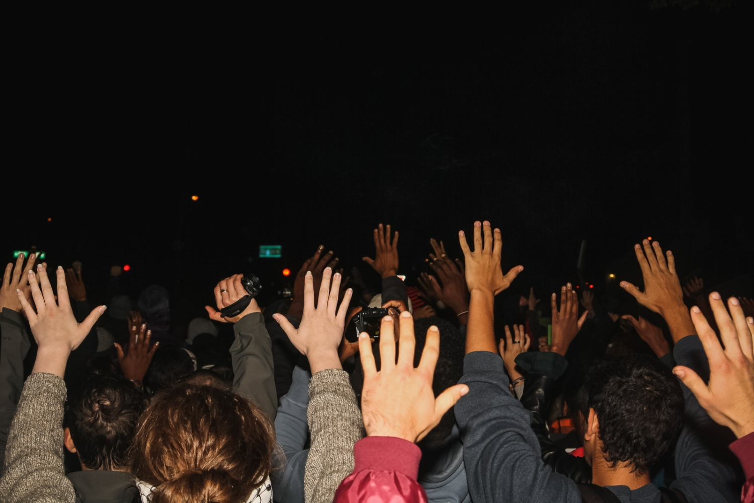 "Activists chant ""Hands Up! Don't Shoot!"" while marching through Ferguson."