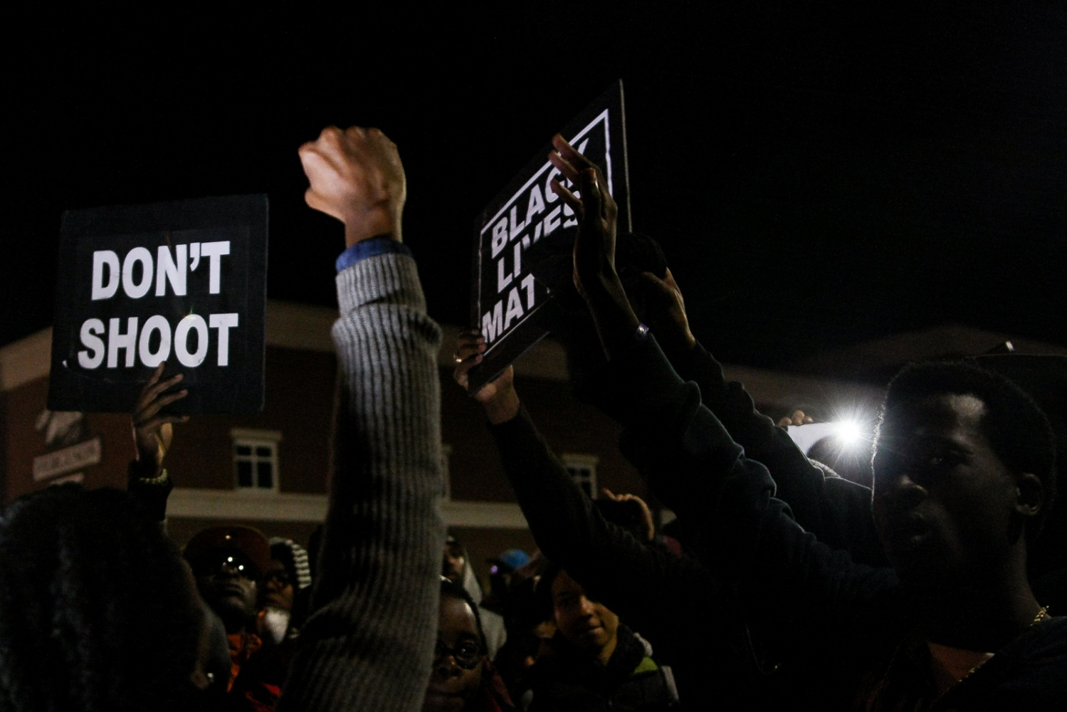 Protestors gather in front of the Ferguson Police Department.