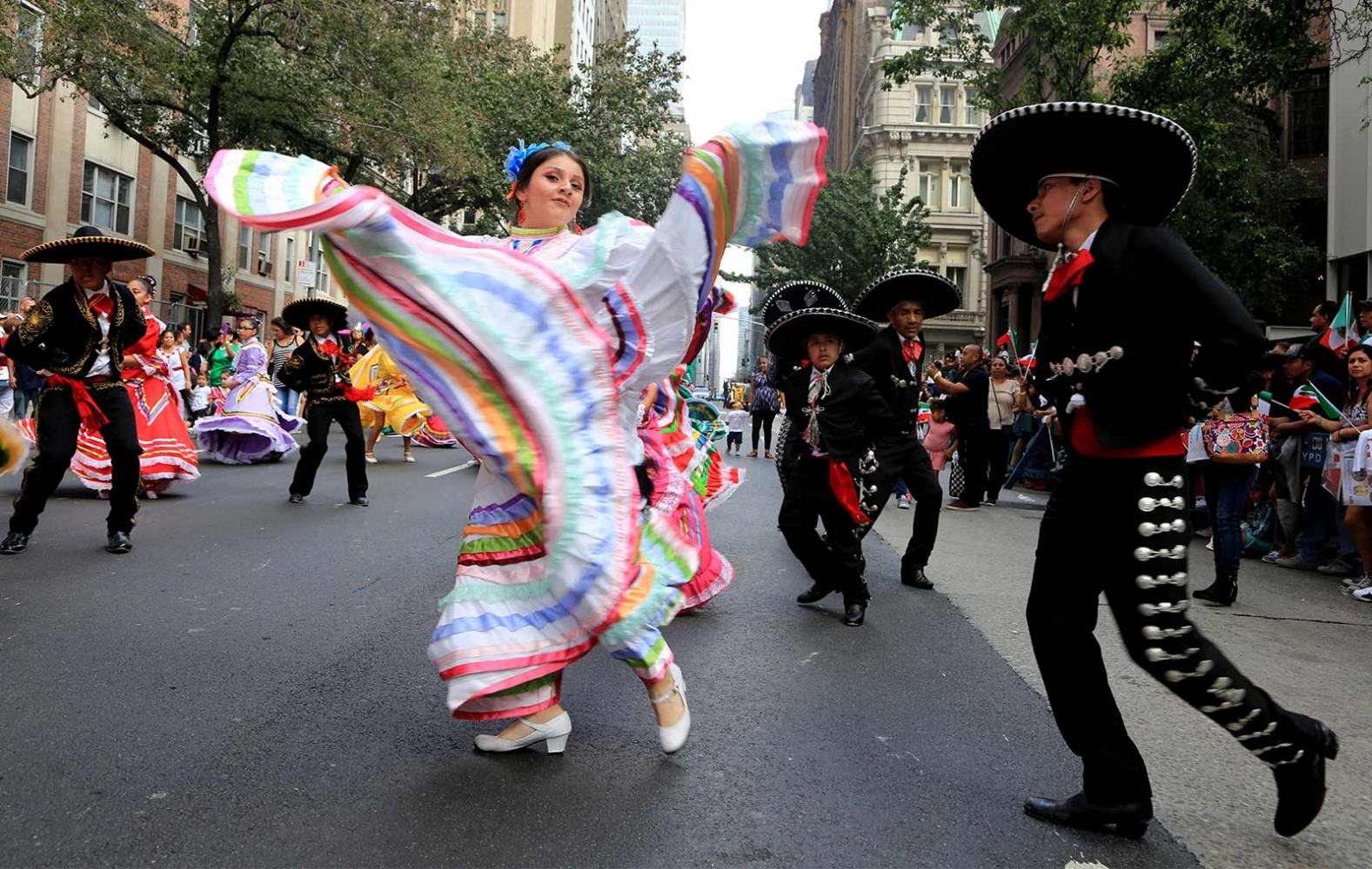 Mexican pride was on full display Sunday as the borough of Manhattan played host to the annual Mexican Day Parade. Thousands of parade-goers lined up along Madison Avenue to watch the festivities adorned with the country red, white and green flags.