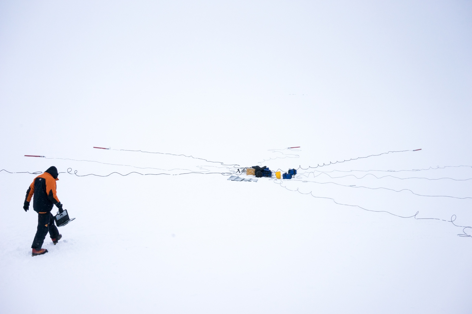 Dr. Martyn Unswoth calibrates magnetometers on the Ross Ice Shelf outside of McMurdo station.
