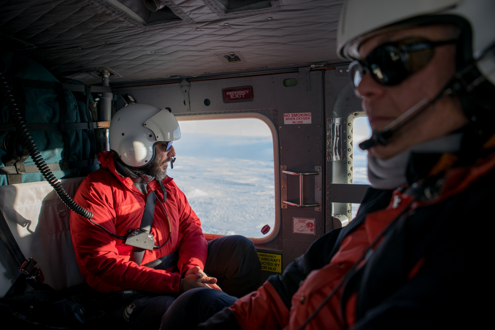 Dr. Phil Wannamaker and Dr. Paul Bedrosian en route to an installation on Mt. Erebus in a Bell 212 helicopter.