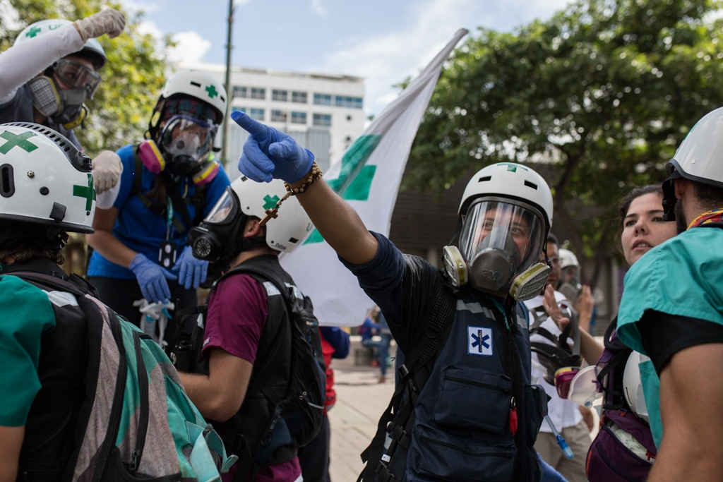 Once the protest is over, green cross members collect their equipments and get ready to come back to their meeting point. Las Mercedes, Caracas, Venezuela. June 19, 2017.