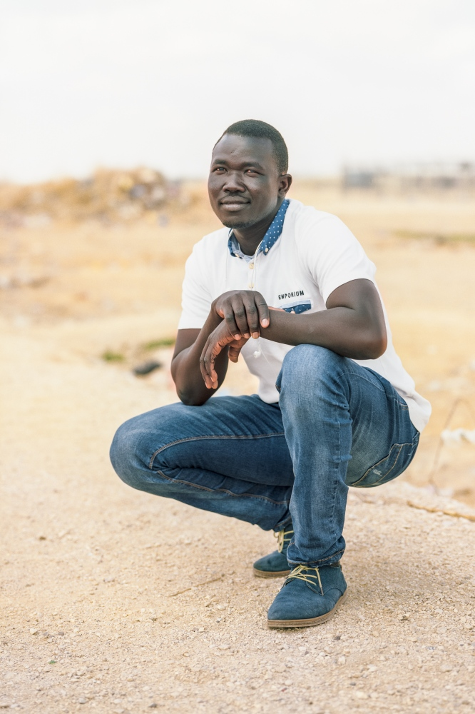 "Adam Fathi, 29 – South Sudan Adam was born in 1987 in the Nuba Mountains of South Kordofan, Sudan. In 1997, he moved to Khartoum with his father to learn Arabic and graduated at the age of sixteen. ""Had I become a Muslim, I would have received a passport, but I did not want to."" He was then conscripted to do military service. After a year, he was to go to war against South Sudan - against 'his own people'. When he refused, they threatened to kill him and he was imprisoned for three years. In prison he was tortured – he has severe burns on his body and scars of shackles and beatings. In 2005, during peace negotiations between North and South Sudan, he was lucky to be released via a prisoner exchange. He stayed in Khartoum and trained as electrician. Still pressured to become a Muslim, he was again arrested in 2012, this time for six months. He then escaped Sudan and made it to Israel with difficulty. After five years of working in Israel, he has been in Holot for three months now. Israeli authorities are threatening to send him to South Sudan, which is independent now but at war. He hopes for help: ""I want to live, not fight."""