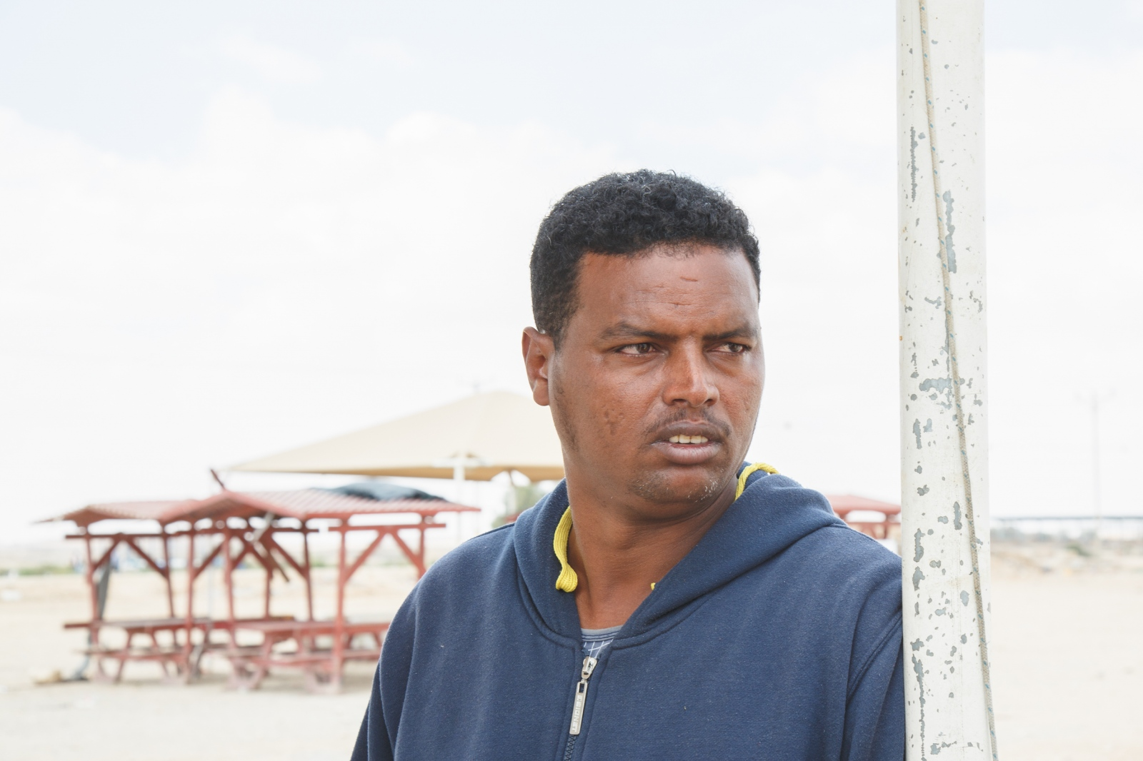 "Mtseamlak Tsfazg, 37 – Eritrea Mtseamlak fled Eritrea for the reason that he was in military service and therefore afraid for his life. Since he could not raise any money for smugglers, he initially stayed in Sudan for ten months. He made it to Israel in 2012 but first came to Saharonim prison in the Negev desert for one and a half years. He then worked near Gaza and now has been in Holot since five months. His wife and children are still in Eritrea. Mtseamlak has not been able to cope well with his escape and the time in Israeli prison: ""I am calling for help – and I don't know why it is taking so long."""