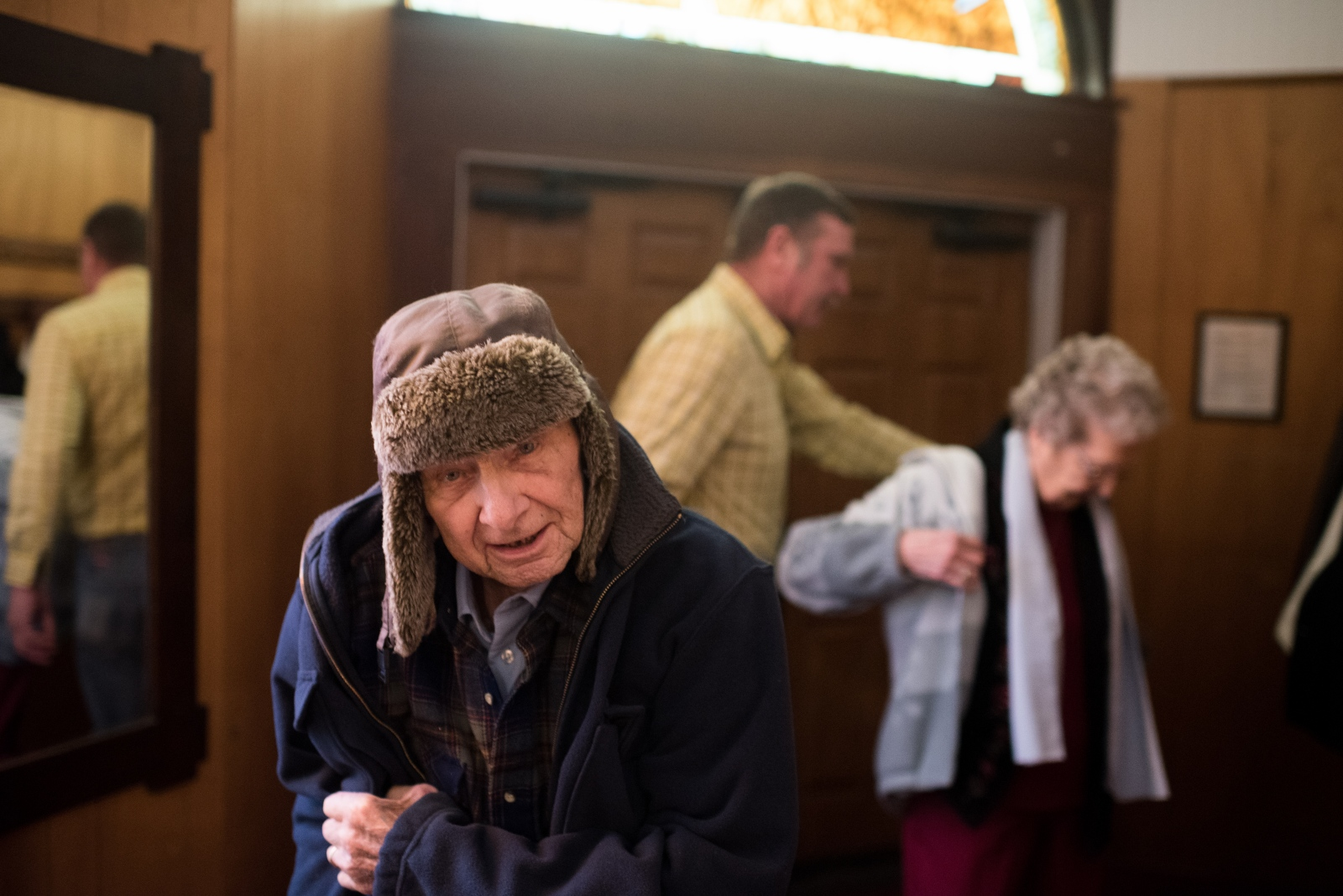 (left to right) Richard Vales, his son Bob Vales, and wife Joyce Vales, all prepare to leave the Coolville United Methodist Chruch after a service in February 2015.