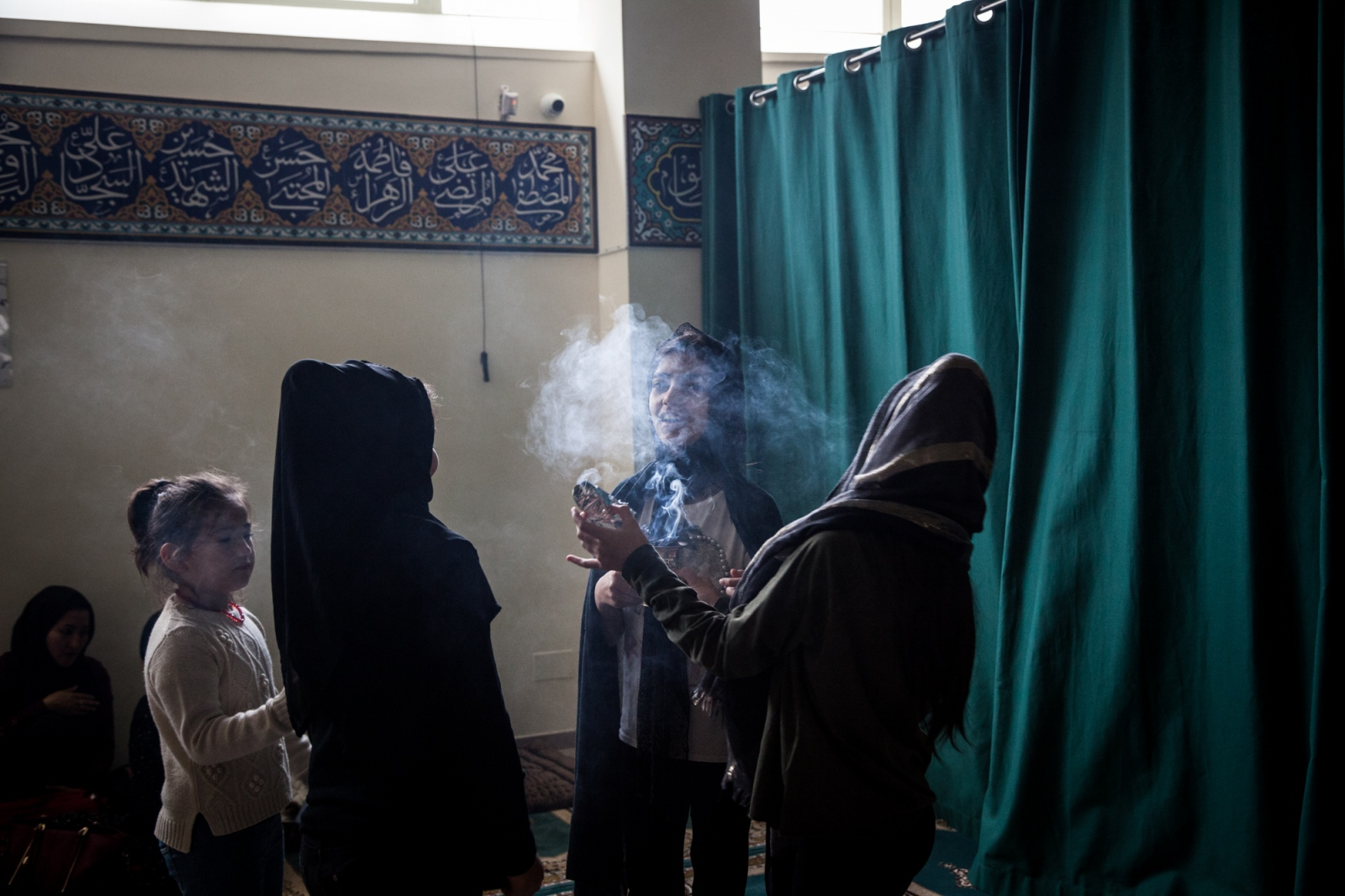 Oct. 1, 2017 -  Girls play with incense at the Islamic Centre Imam Mahdi, where about two hundred Shiia Muslims have gathered to celebrate the day of Ashura. This mosque, located in the eastern neighborhood of Furio Camillo, is the only Shia mosque in Rome.