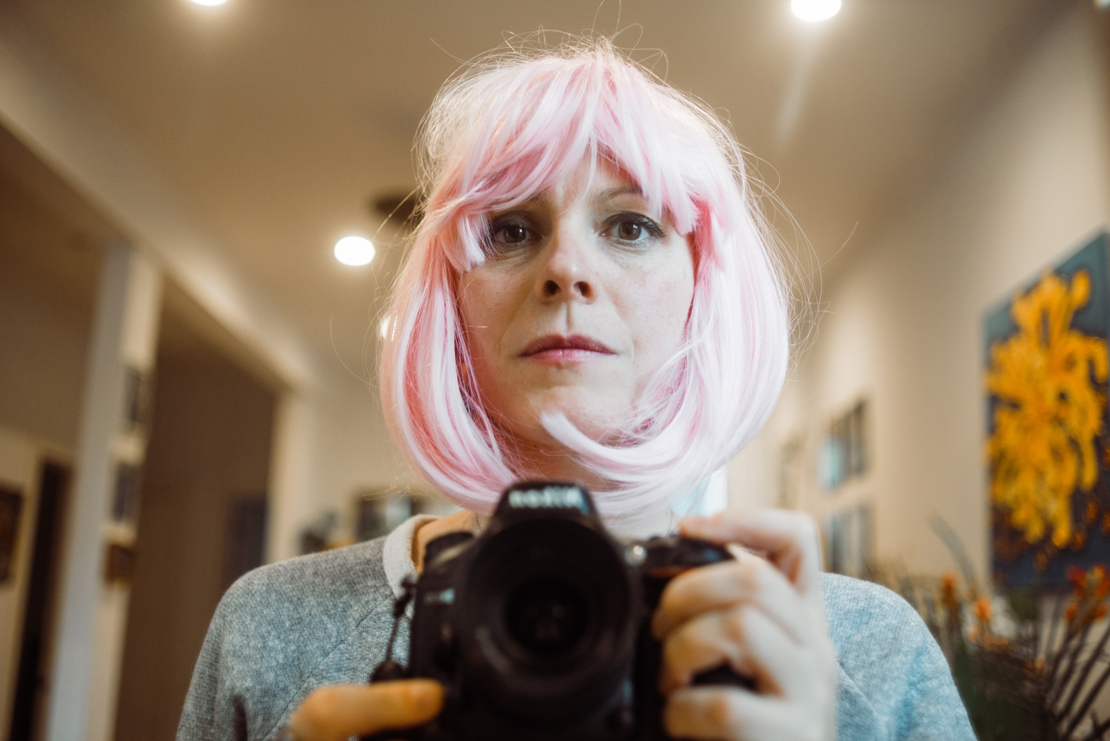 Anna tries on a pink wig she purchased along with four other colors. She would never actually wear any of the wigs during the course of treatment, opting instead for head scarves and hats.