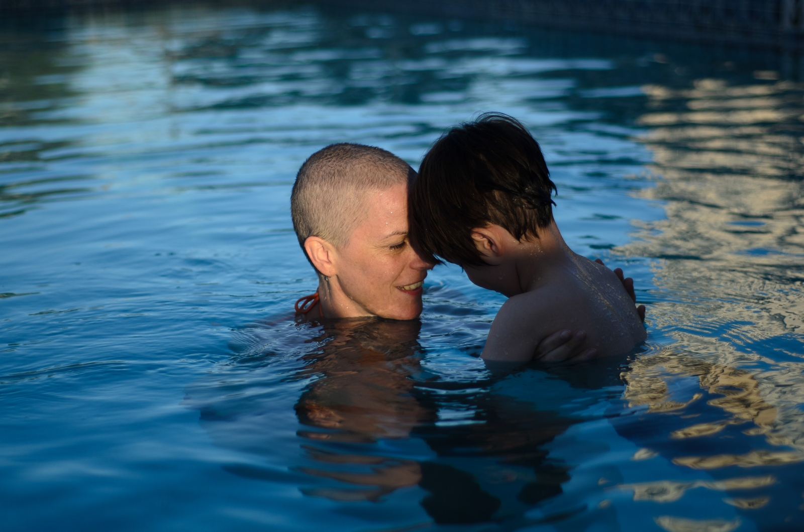 Between chemotherapy and radiation treatment, Anna and Jesse swim on vacation in Florida. Swimming helps her body recover from the aches and pains of chemotherapy.