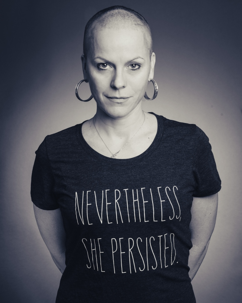 Anna poses for a shaved head portrait. She uses this image for her social media account profile photos.