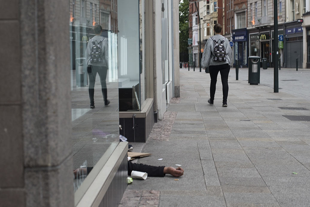 Grafton Street, the main shopping street in Dublin, on a Sunday morning. The crowd is so used to see homeless people sleep everywhere they don't even look around anymore.