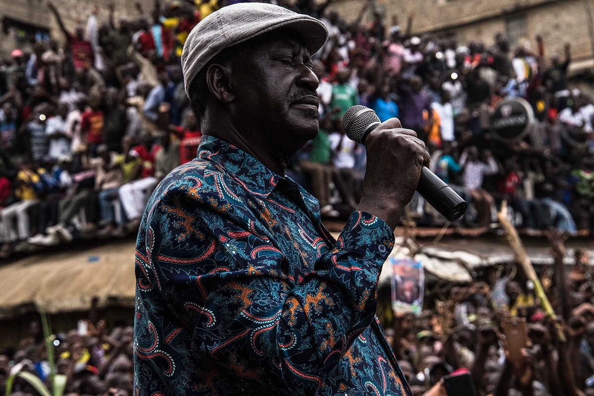 Kenyan opposition leader Raila Odinga stands through the roof of his vehicle as his convoy is mobbed by thousands of supporters gathered in the Mathare area of Nairobi, Kenya Sunday, Aug. 13, 2017. Kenya's defeated opposition leader Raila Odinga on August 13 urged his supporters to boycott work, promising to announce on August 15 his strategy after an election he claims was stolen from him.