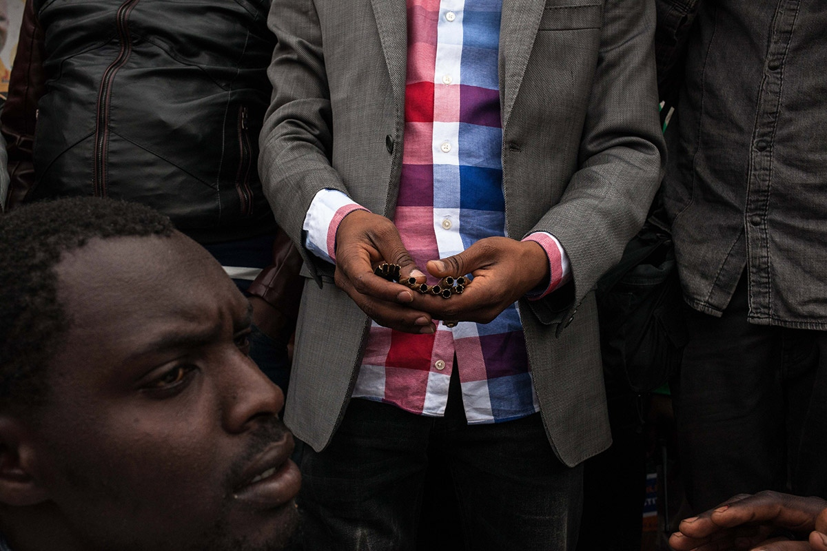 Orange Democratic Movement MP for Mathare, T.J. Kuwang, addresses residents of the Mathare slum in Nairobi on August 12, 2017, showing them some of the bullets used by the police to suppress the protests. Kenya's defeated opposition coalition vowed that they would not halt their bid to overturn a 'sham' election result, which sparked violent protests that have left 11 people dead. Protests flared in opposition bastions as soon as President Uhuru Kenyatta was declared the victor late August 11, after an election his rival Raila Odinga claimed was massively rigged.