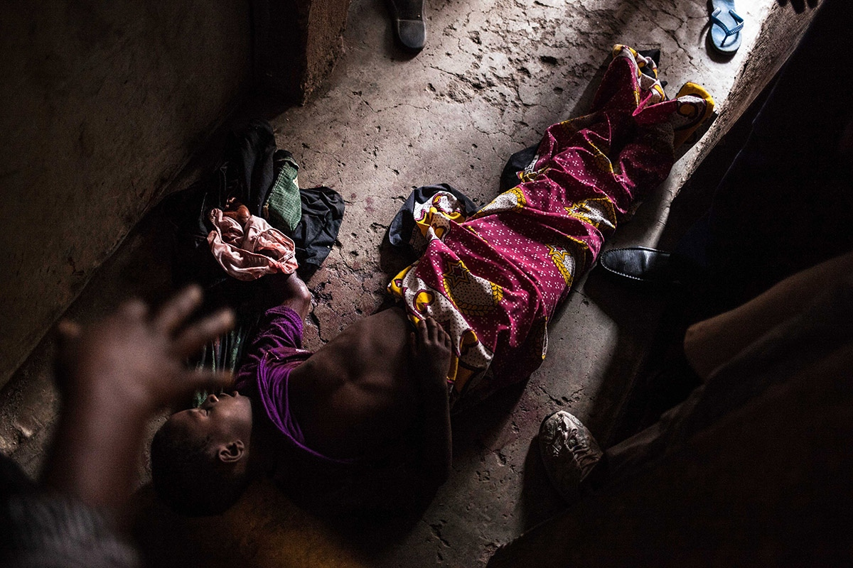 The body of a 9-year-old girl lies in a hallway in the Nairobi area of Mathare, Saturday, Aug. 12, 2017. The girl was shot dead during clashes between Kenyan security forces and supporters of opposition leader Raila Odinga. Kenya's post-election violence worsened Saturday as police used tear gas on a convoy of opposition officials in the capital and a mortuary official said nine bodies with gunshot wounds were brought to a Nairobi morgue from a slum that's an opposition stronghold.