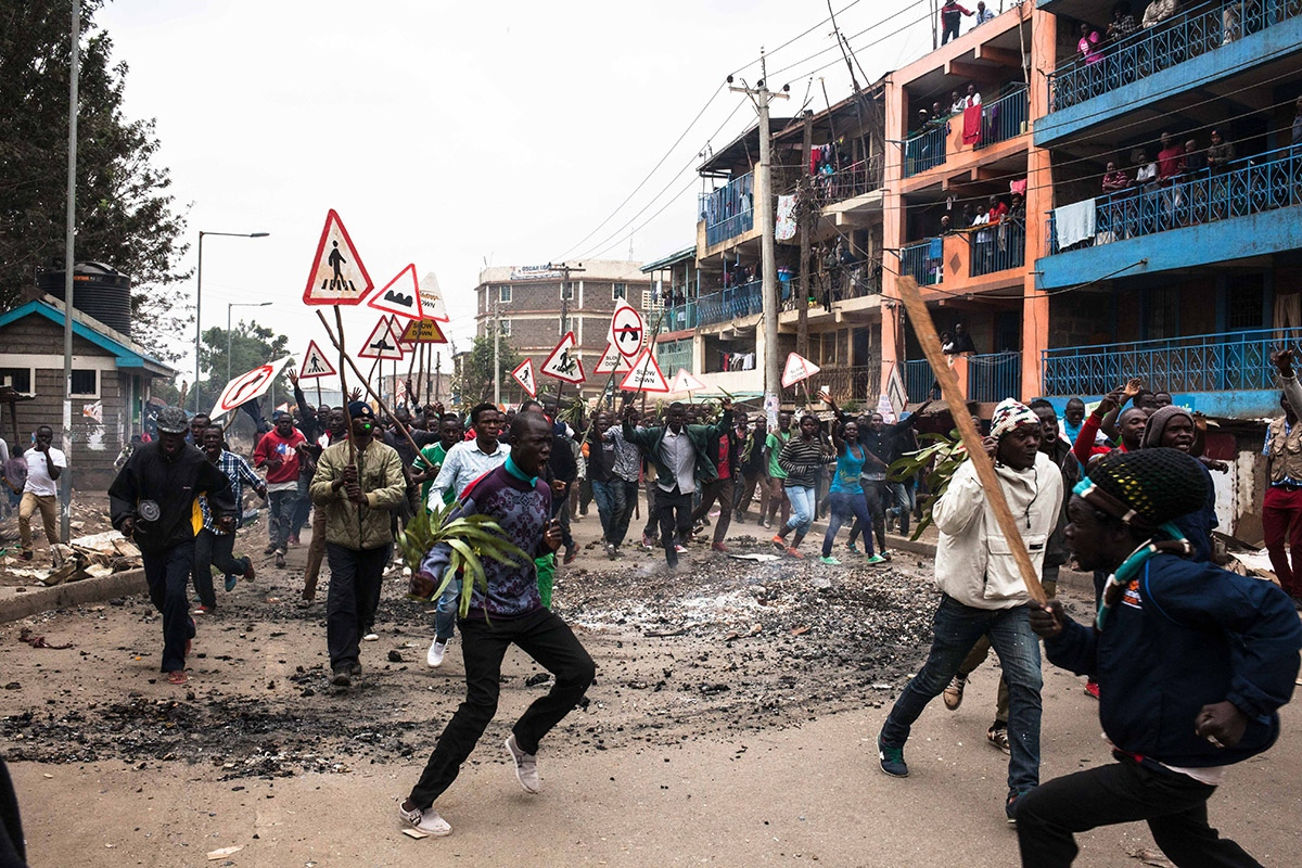 On August 9th 2017, day after Kenya´s presidential elections, protestants roam the streets of Mathare slum in Nairobi, encouraging people to join protests over the electoral defeat of opposition candidate Raila Odinga. Following the official announcement of the results, which give the current president Uhuru Kenyatta as a winner, opposition candidate Raila Odinga claimed to have evidence of electoral fraud and called his voters to protest peacefully.