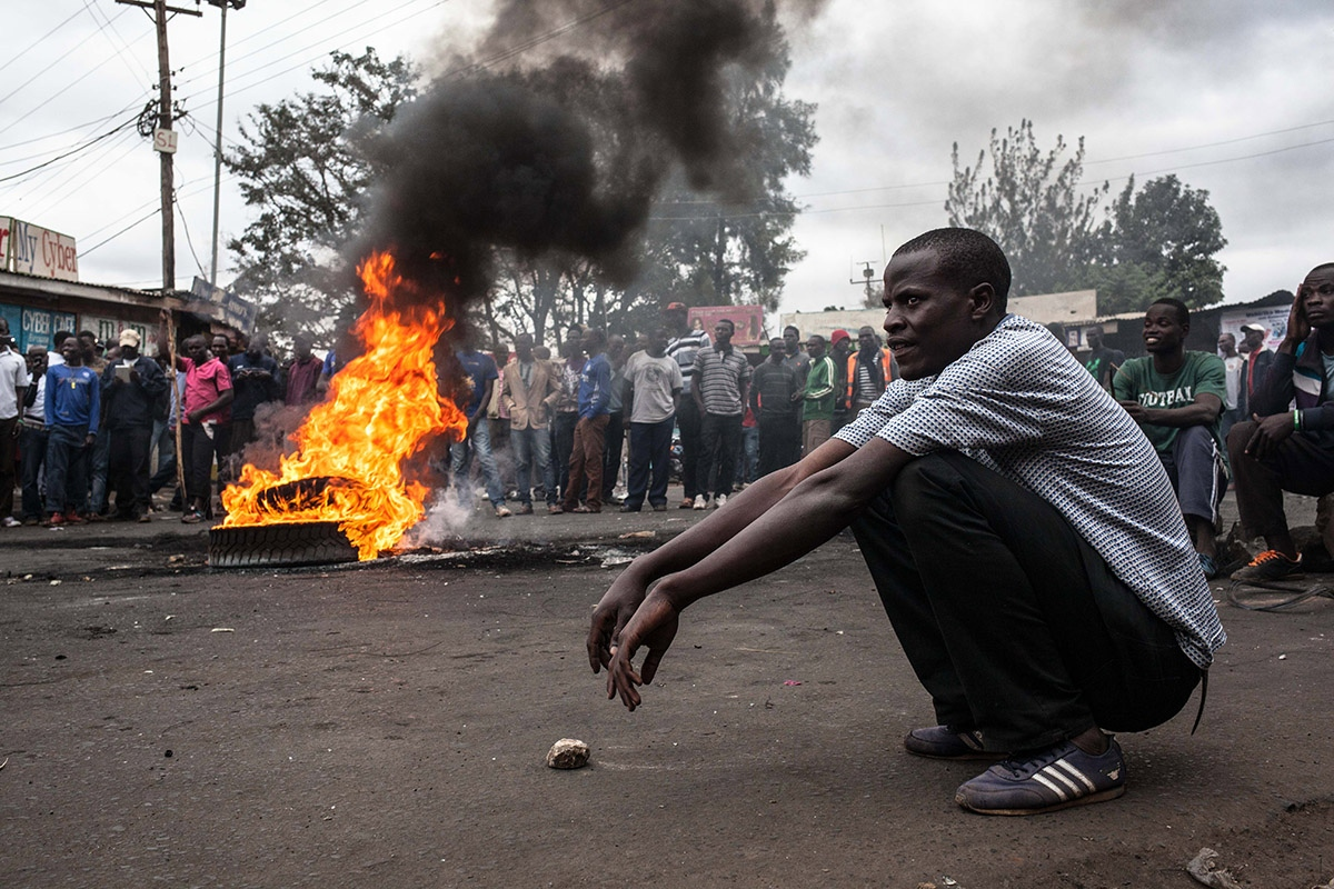 Post-election violence erupts in opposition strongholds in Kenya following the official announcement of results, which confirm the victory of the current president of Kenya, Uhuru Kenyatta. A group of men from Kibera slum, Africa's largest slum, burned wheels in the street while during the protests and confrontation with the police.