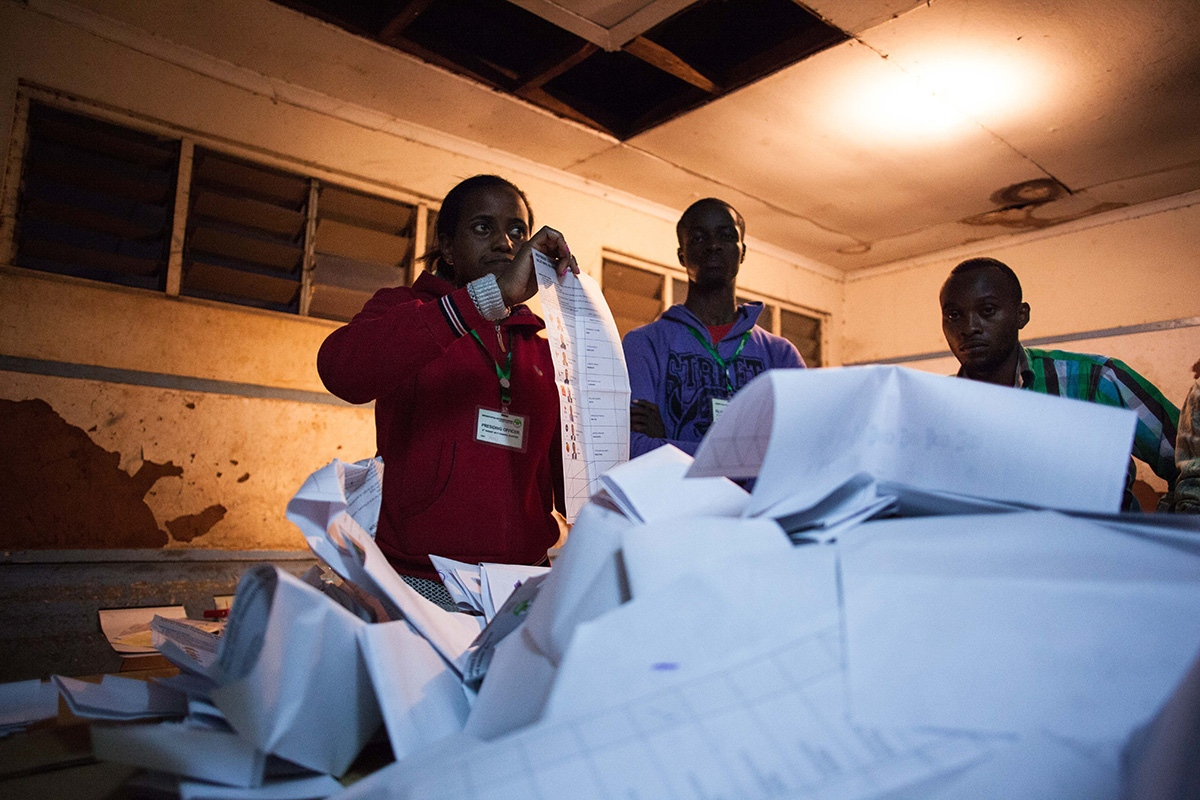 A presiding officer during vote-counting at a polling centre in Nairobi, Kenya, after the closure of the polling stations on 8th August 2017, day of the presidential elections.
