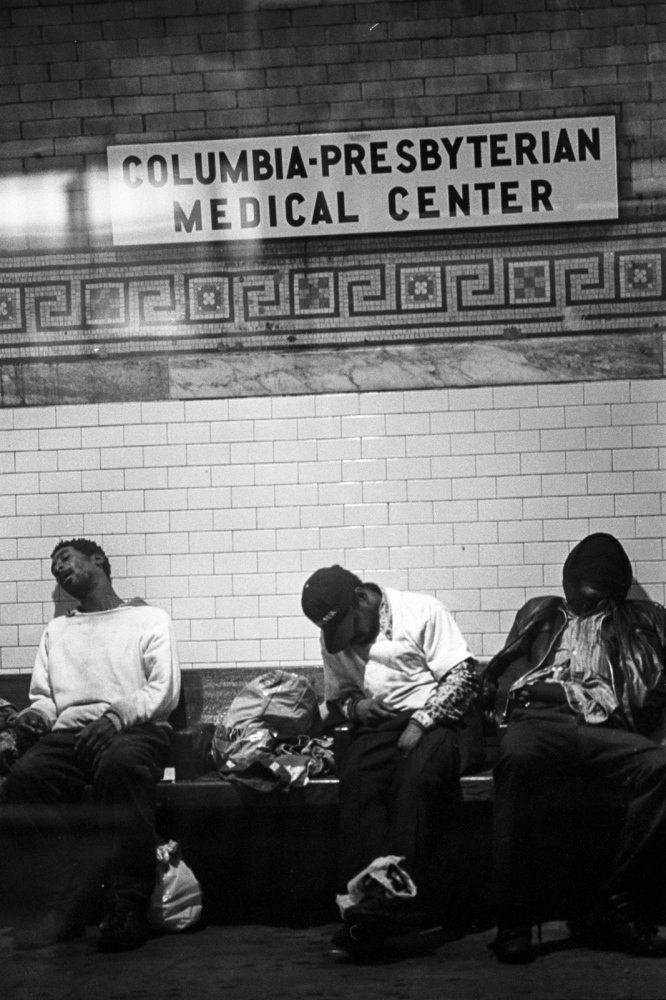 Three homeless men sleeping on a subway bench. Upper west side 1993