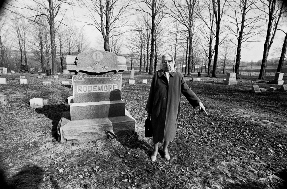 Alice, showing us her family plot and pointing to where she will be burried, Knoxboro, NY 1977