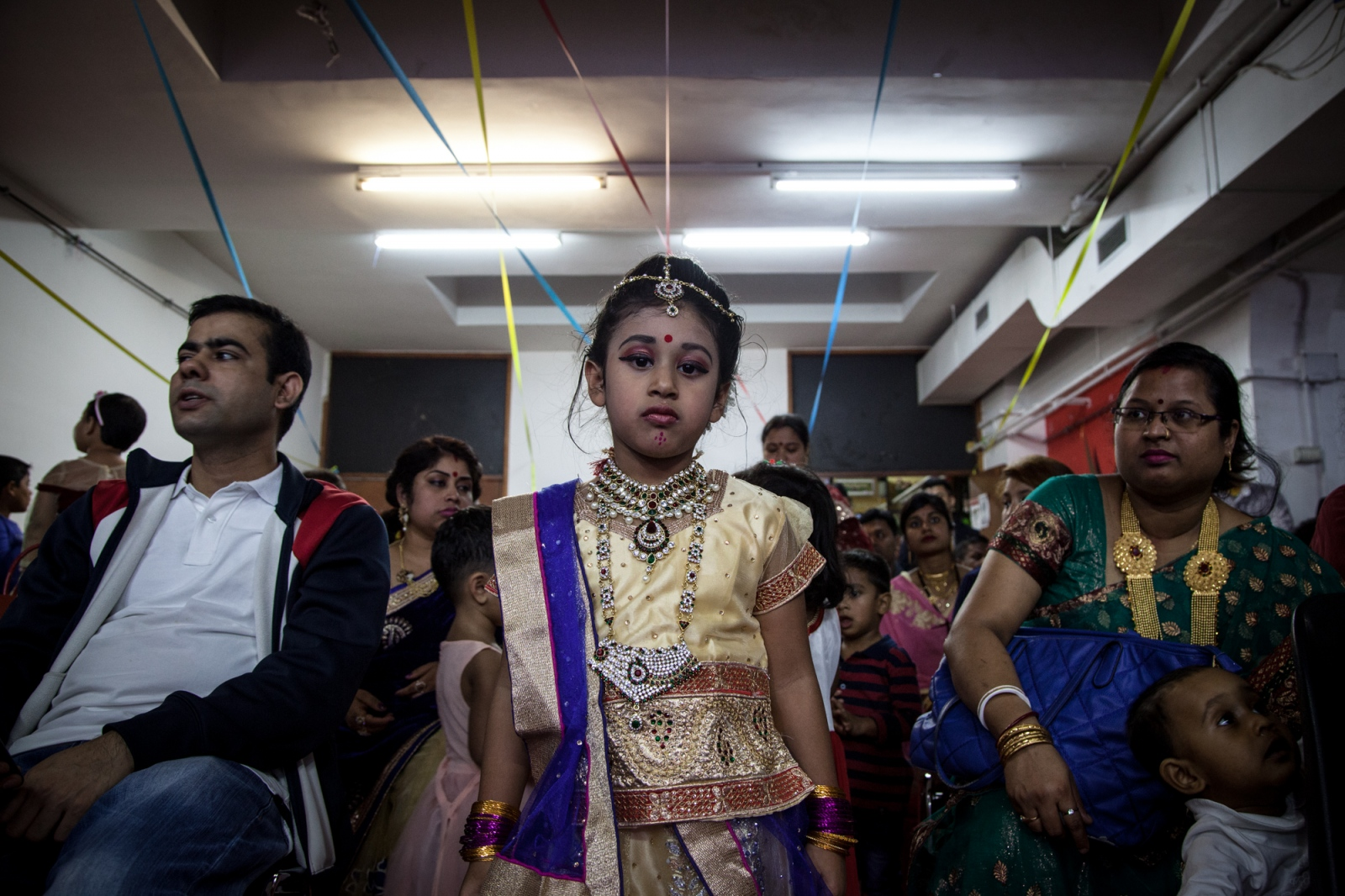 Sept. 29, 2017 - A young girl in traditional Hindu clothes poses for a portrait during Durga Puja celebration. night, in one of the many rooms that the Hindu community has rented for the holiday in Torpignattara, a working class neighborhood in southeast Rome.