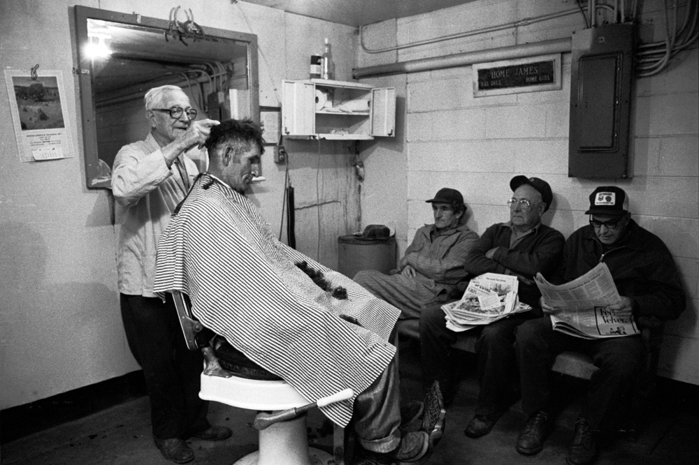 "The barber shop at Burton's Livestock Excahnge. The man sitting in the barber's chair and the one to the far left are two of  the Ward brothers, who were the subjects of the 1992 film, ""Brother's Keeper,"" by Joe Berlinger and Bruce Sinovsky and were accused of murdering their third  brother, Delbert, who died under mysterious cirumstances - later adquited."