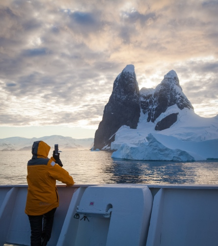 A tourist snaps a photo of the Lemaire Channel in Antarctica.